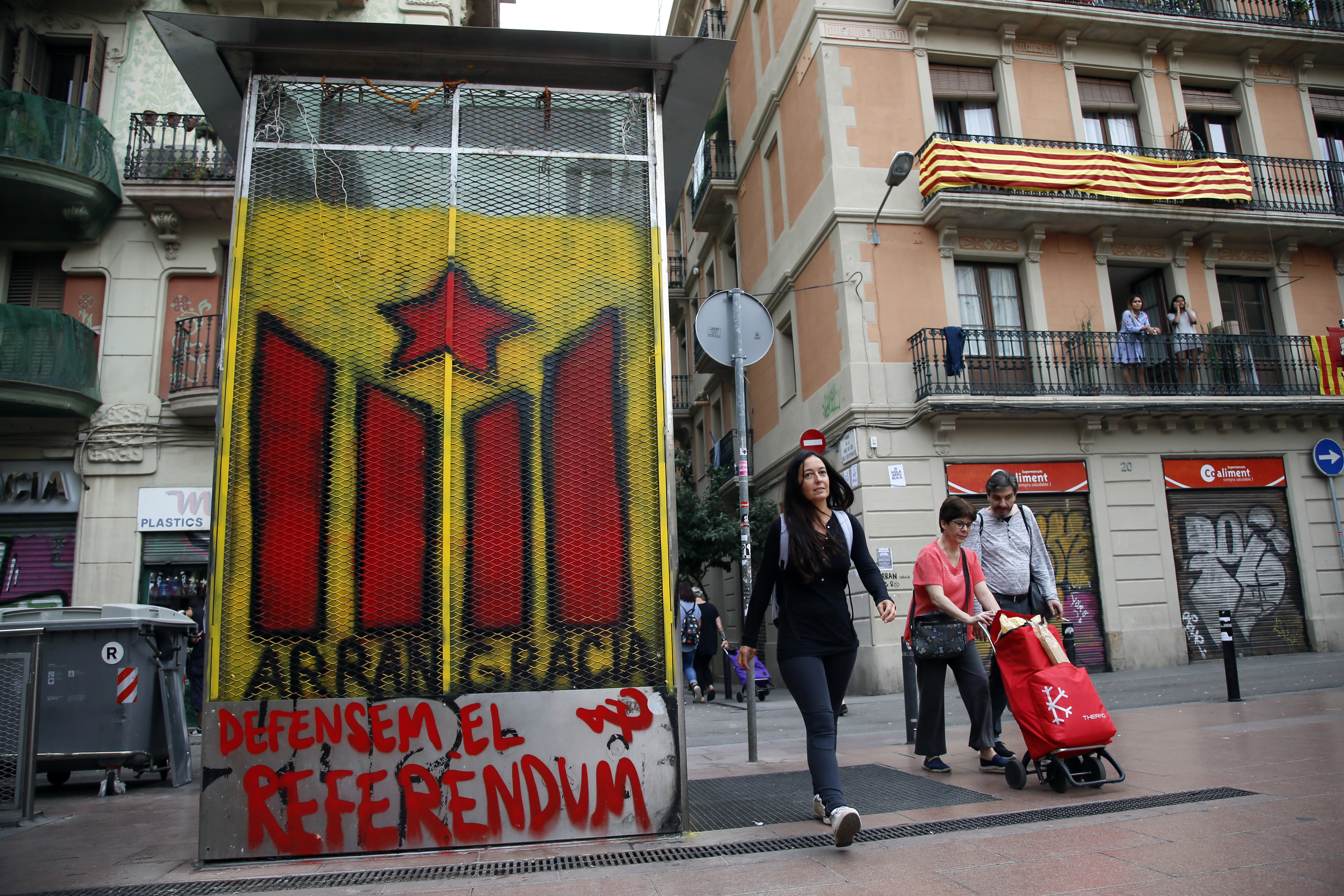 Catalans occupy polling stations to ensure contested independence referendum goes ahead